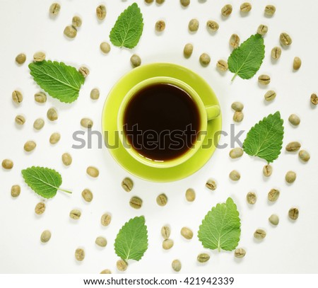 coffee pattern green coffee beans and mint leaves  - stock photo