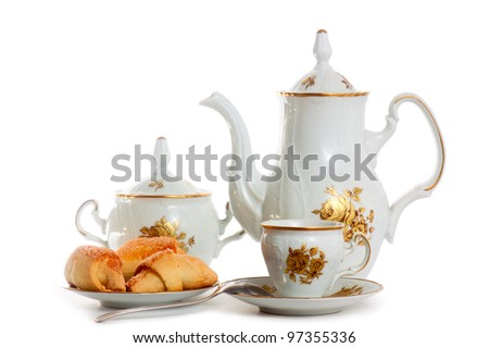 Coffee pot cup saucer cakes sugar spoon - stock photo