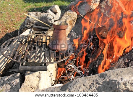Coffee pot on a fire - stock photo