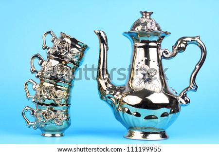 Coffee pot with cups from  service on a blue background