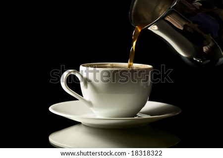 coffee pouring into white cup isolated over black background - stock photo