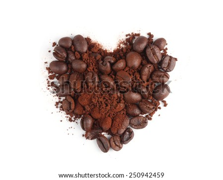 Coffee powder and beans in shape of heart - stock photo