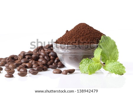 coffee powder and coffee beans scattered on white background - stock photo