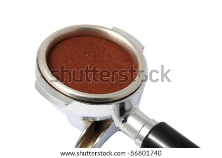coffee powder dose and filled in Group handle, prepare to brew in machine. - stock photo