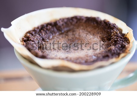 coffee powder in paper filter - stock photo