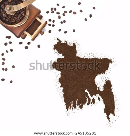 Coffee powder in the shape of Bangladesh and a decorative coffee mill.(series) - stock photo