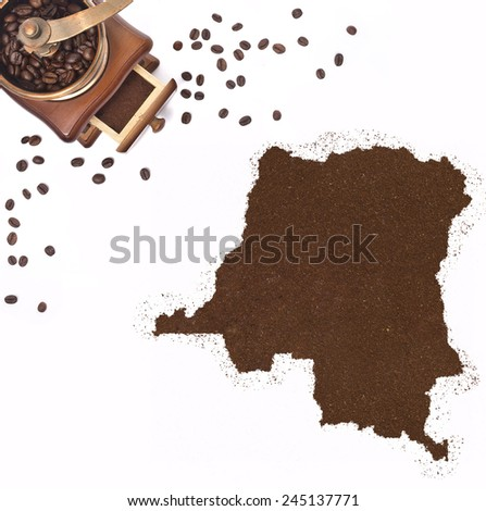 Coffee powder in the shape of Democratic Republic of the Congo and a decorative coffee mill.(series) - stock photo