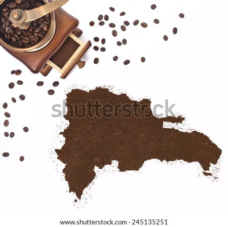 Coffee powder in the shape of Dominican Republic and a decorative coffee mill.(series) - stock photo