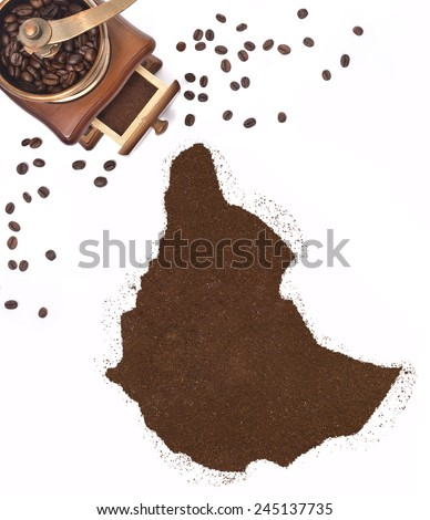 Coffee powder in the shape of Ethiopia and a decorative coffee mill.(series) - stock photo