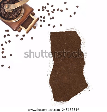 Coffee powder in the shape of Ghana and a decorative coffee mill.(series) - stock photo