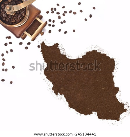 Coffee powder in the shape of Iran and a decorative coffee mill.(series) - stock photo