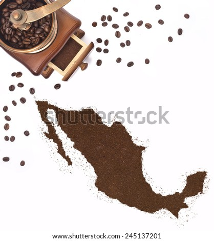 Coffee powder in the shape of Mexico and a decorative coffee mill.(series) - stock photo