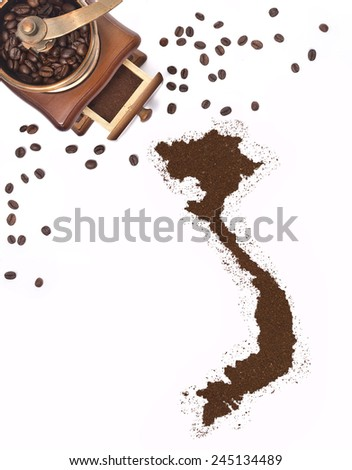 Coffee powder in the shape of Vietnam and a decorative coffee mill.(series) - stock photo