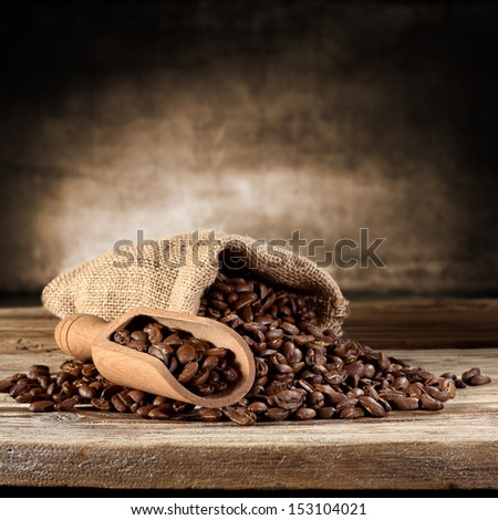 coffee sack and wooden spoon  - stock photo