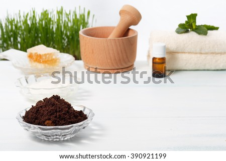 Coffee scrub with honey, yogurt or cream base, mint and essential oil - stock photo