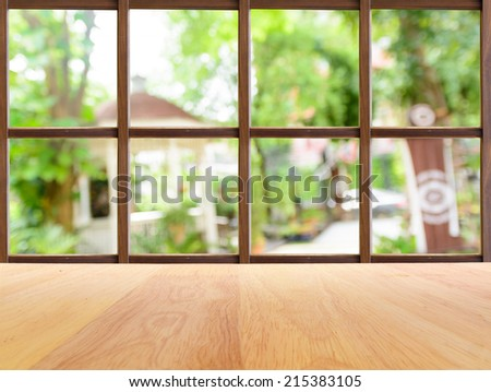 Coffee shop garden view from wooden window - stock photo