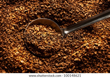 coffee spilling out of spoon