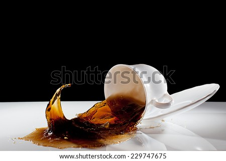 Coffee splash in the flying cup - stock photo