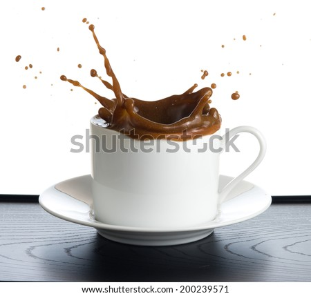 coffee splash isolated on white background - stock photo