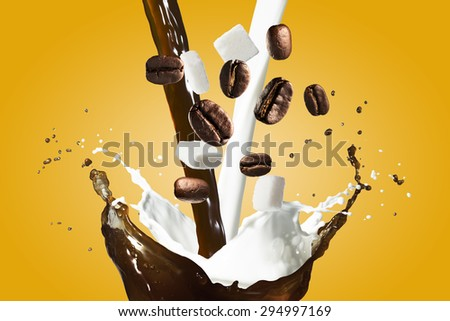 Coffee Splash With Coffee Beans and Milk Pour With Sugar Falling - stock photo