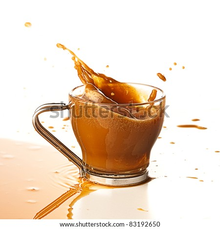 coffee splashing into cup on a white background - stock photo