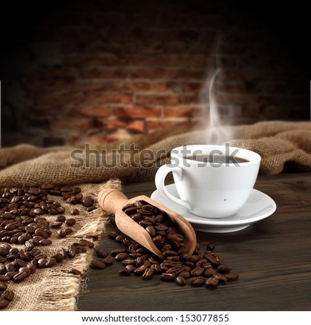 coffee spoon and cup of hot drink  - stock photo