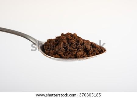 Coffee spoon on white background - stock photo