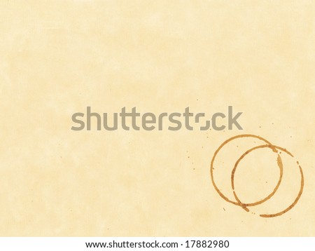 Coffee stain on beige textured paper - stock photo