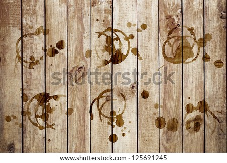 Coffee stains on a grunge old wooden background - stock photo