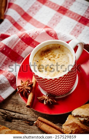 Coffee still life with croissant on wooden background - stock photo