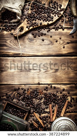 Coffee style. Old coffee grinder with coffee beans. On wooden background. - stock photo