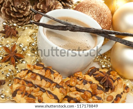Coffee, sweets and spices in christmas decoration - stock photo
