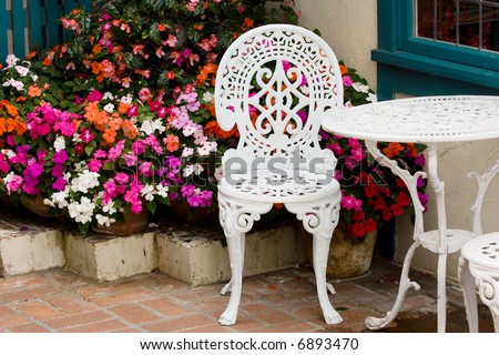 Coffee table at cafe's backyard - stock photo