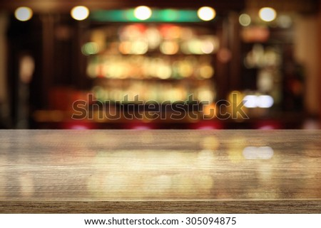 coffee table in bar and space for your decoration of bottle and glass  - stock photo