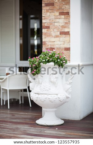 Coffee table with vase - stock photo