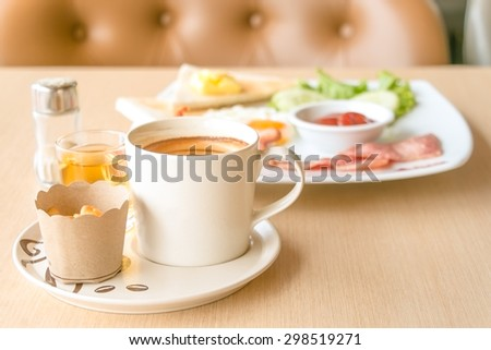 coffee,tea,biscuits  and set of breakfast on vintage wood table - stock photo