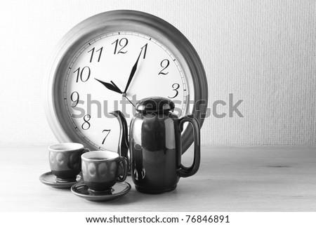 Coffee time: coffee set and clock. B&W image. - stock photo
