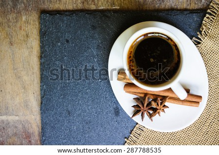 Coffee time, cup of black coffee and cinnamon and anise spices, Good morning note - stock photo