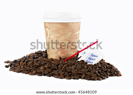 Coffee to go cup, with lid, in coffee beans on a white background with copy space.  Stirrers and sugar included. - stock photo