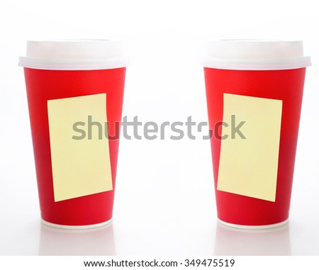 Coffee to go. Two paper coffee cups with blank yellow sticky notes - stock photo