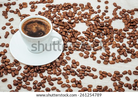 Coffee turk and Cup of Coffe and smile . Coffee beans in shape of heart. coffee beans isolated on white background. roasted coffee beans, can be used as a background. - stock photo