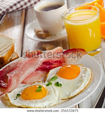 Coffee , Two  eggs  and bacon for healthy breakfast . selective focus
