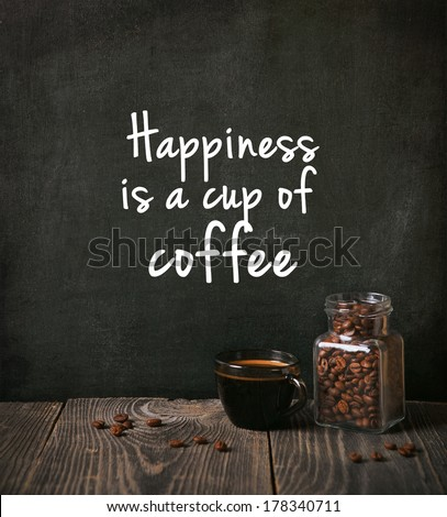 coffee with beans and written phrase - stock photo