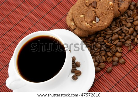 Coffee with chocolate cookies and grains