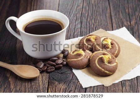 Coffee with chocolate cookies on dark wooden table - stock photo