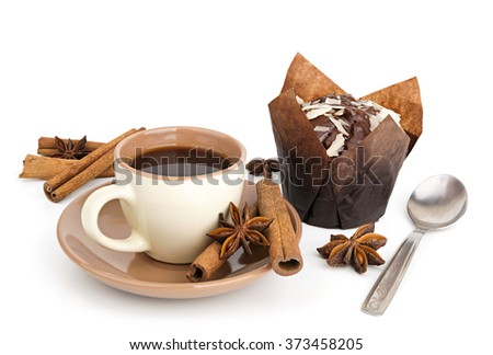 Coffee with cinnamon and chocolate muffin on white background