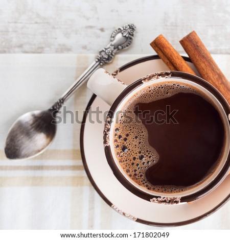 Coffee with cinnamon - square - stock photo