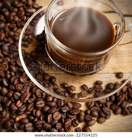 coffee with coffee beans, brown sugar on wooden table