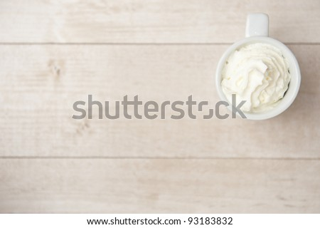 Coffee with cream over a wood table