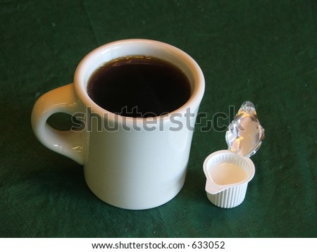 coffee with creamer on the side - stock photo
